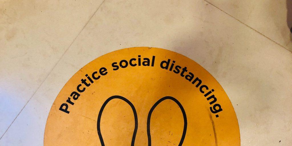 Social distancing sign on floor