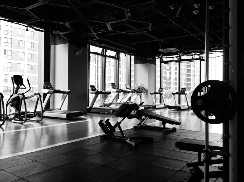 A black and white image of an empty gym